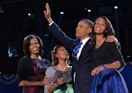 President Barack Obama, First Lady Michelle and daughters Sasha and Malia wave to supporters on election night in Chicago on November 6, 2012 -- Getty Premium