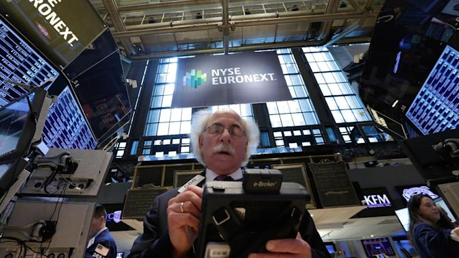 Trader Peter Tuchman works on the floor of the New York Stock Exchange Wednesday, April 10, 2013. Stocks are opening higher on Wall Street, a day after the Dow Jones industrial average closed at its second all-time high in a week. (AP Photo/Richard Drew)
