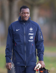 French goalkeeper Steve Mandanda arrives to a training session at Clairefontaine training center, in Clairefontaine, west of Paris, Wednesday Nov. 9, 2011. France will play U.S. Friday in an international friendly soccer match. (AP Photo/Thibault Camus)