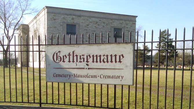 Authorities say a casket containing the body of 93-year-old Clarence Bright was stolen from Gethsemane Cemetery, seen Tuesday, Jan. 15, 2013 in Detroit. Police say two men have been arrested, including a 48-year-old reported to be the son of the deceased, on suspicion that they stole a Bright's body and casket from the cemetery on Monday. (AP Photo/Ed White)