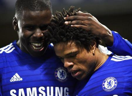 Chelsea's Loic Remy celebrates his goal with teammate during their English Premier League soccer match against Manchester City at Stamford Bridge in London