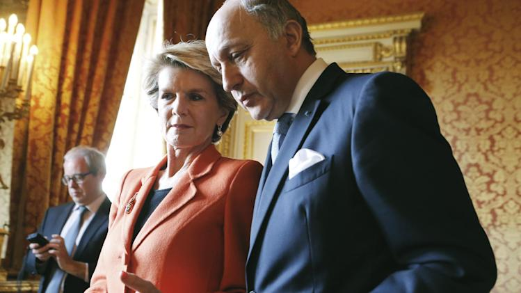 Australian Foreign Minister Julie Bishop, left, talks with French Foreign Minister Laurent Fabius after their meeting at the Quai d'Orsay in Paris, Wednesday, April 23, 2014 (AP Photo/Jacques Brinon)