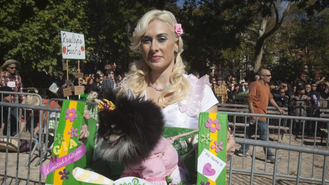 Victoria Viscardi arrives with her dog Gia during the 24th Annual Tompkins Square Halloween Dog Parade in New York