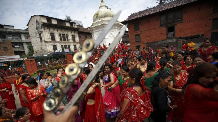Women sing and dance at the premises of Pashupatinath Temple during the Teej festival in Kathmandu