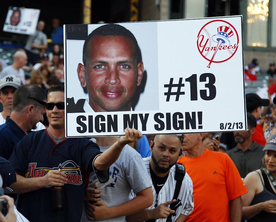 A New York Yankees' fan holds up a sign with Alex Rodriguez's photo as he signed autographs prior to a Class AA baseball game with the Trenton Thunder against the Reading Phillies, Friday, Aug. 2, 2013, in Trenton, N.J. (AP Photo/Tom Mihalek)