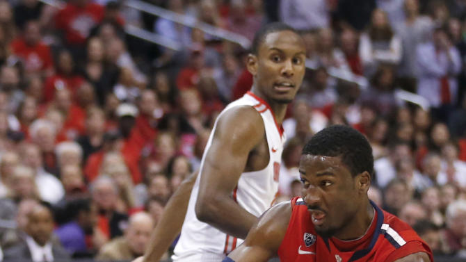 Arizona's Solomon Hill hangs on to the ball as Ohio State forward Sam Thompson, rear, watches during the second half of a West Regional semifinal in the NCAA men's college basketball tournament, Thursday, March 28, 2013, in Los Angeles. (AP Photo/Jae C. Hong)