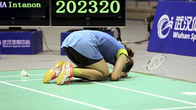 Ratchanok of Thailand celebrates after defeating Li of China during their women's singles final match at the 2015 Badminton Asia Championships, in Wuhan