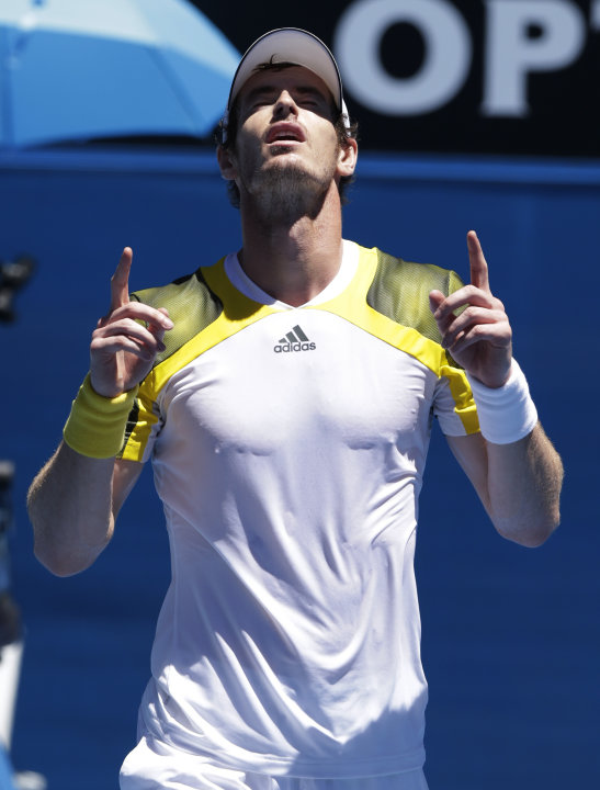 Britain's Andy Murray celebrates after defeating Robin Haase of the Netherland in their first round match at the Australian Open tennis championship in Melbourne, Australia, Tuesday, Jan. 15, 2013. (A