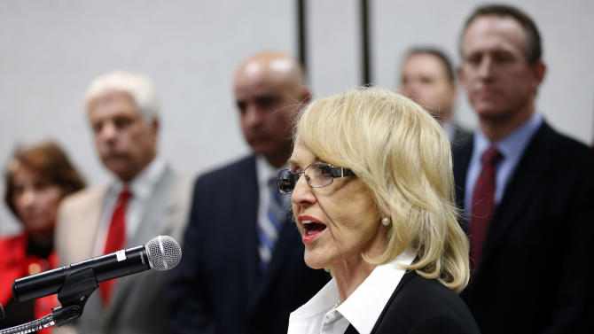 Arizona Gov. Jan Brewer, R, calls for the expansion of Medicaid, Wednesday, Jan. 26, 2013 in Phoenix with healthcare and business leaders at Maricopa Medical Center. An expansion would call for $8 billion in federal assistance for the State over three years. (AP Photo/Matt York)