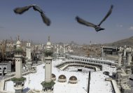 RNPS IMAGES OF THE YEAR 2012 - Pigeons fly over the Grand Mosque at Friday prayers during the annual haj pilgrimage in the holy city of Mecca October 19, 2012. The Arafat Day, when millions of Muslim pilgrims will stand in prayer on the mount of Arafat near Mecca at the peak of the annual pilgrimage, will be held on October 25 and Eid al-Adha or the feast of sacrifice will be held on October 26, according to an official announcement on Tuesday. REUTERS/Amr Abdallah Dalsh  (SAUDI ARABIA - Tags: RELIGION ANIMALS TPX IMAGES OF THE DAY)
