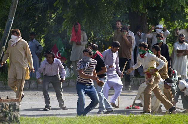 Pakistani protestors throw stones toward the police during clashes that erupted as protestors tried to approach the U.S. embassy, Friday, Sept. 21, 2012 in Islamabad, Pakistan. Protests by tens of tho