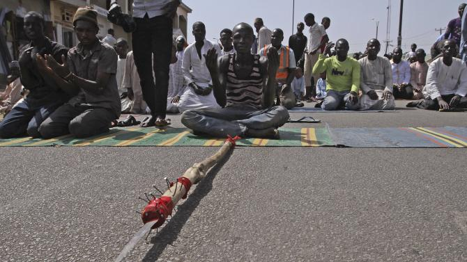 Youth volunteers take turns to pray during Friday prayers at a mosque near Specialist Hospital Gombe