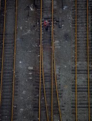 Railroad tracks West of Penn Station bear a brown color Wednesday, Oct. 31, 2012, in New York. Travel in the Northeast creaked back into motion on Wednesday, a grinding, patchy recovery that made it clear that stranded travelers will struggle to get around for days to come. (AP Photo/Craig Ruttle)
