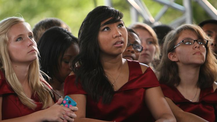 From left, Courtney Brakob, 16, Ivanna Aparejo, 16, and Cynthia Herrera, 17, listen to President Barack Obama's speech at Virginia Beach's  Farm Bureau Live, Thursday afternoon Sept. 27, 2012. The three are members of the Visual and Performing Arts Academy at Salem High School in Virginia Beach, VA., and were among the choir who sang prior to Obama's appearance.  (AP Photo/The Virginian-Pilot, Stephen M. Katz)  MAGS OUT