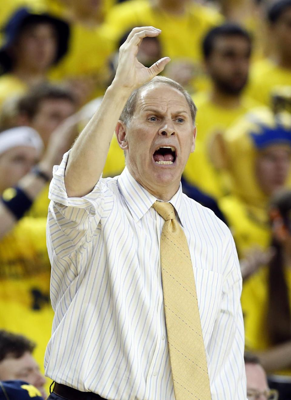 Michigan coach John Beilein shouts instructions from the bench during the second half of an NCAA college basketball game against Indiana Sunday, March 10, 2013, in Ann Arbor, Mich. Indiana defeated Michigan 72-71. (AP Photo/Duane Burleson)