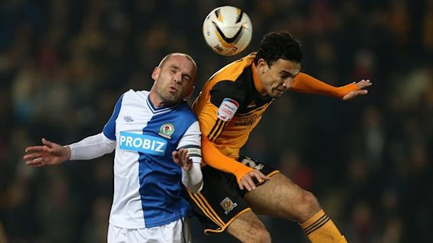Hull City's Gedo (right) and Blackburn Rovers' Danny Murphy battle for the ball in the air (PA Photos)