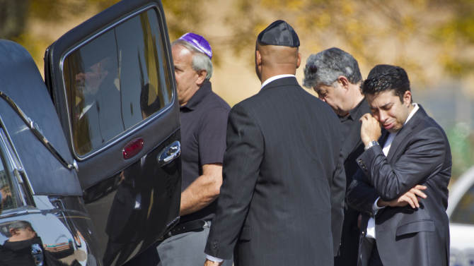 A pallbearer cries after carrying the casket of Reuven Rahamim to the hearse at Beth El Synagogue in St. Louis Park, Minn., on Sunday, Sept. 30, 2012. Rahamim was killed in a workplace shooting Thursday. Andrew Engeldinger, 36, walked into the Minneapolis business on Thursday afternoon and fatally shot five people. (AP Photo/Star Tribune, Renee Jones Schneider)