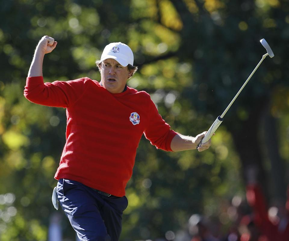 USA's Jason Dufner reacts after making a birdie putt on the 13th hole during a singles match at the Ryder Cup PGA golf tournament Sunday, Sept. 30, 2012, at the Medinah Country Club in Medinah, Ill. (AP Photo/Charles Rex Arbogast)