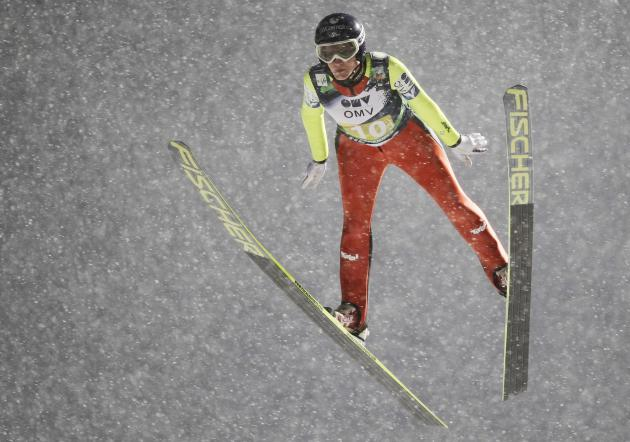 Iraschko of Austria competes during the FIS World Cup ski jumping mixed team competition in Lillehammer