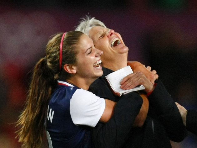 Alex Morgan (L) of the U.S. celebrates with her coach Pia Sundhage after defeating Canada in their women's semi-final soccer match during the London 2012 Olympic Games at Old Trafford in Manchester August 6, 2012. REUTERS/David Moir (BRITAINSPORT SOCCER - Tags: SPORT OLYMPICS SOCCER TPX IMAGES OF THE DAY)