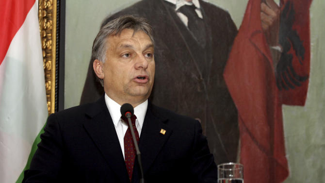 """FILE - This is a Wednesday, Nov. 28, 2012 file photo of Hungarian Prime Minister Victor Orban as he speaks at a news conference in Tirana where he went to celebrate Albania's 100th anniversary of independence. A Hungarian opposition group said Tuesday July 29, 2014 it would ask the European Union to step up its oversight of democracy in Hungary after the Prime Minster Vicktor Orban said he wants to transform the country from a liberal democracy into an """"illiberal state.""""(AP Photo/Hektor Pustina, File)"""