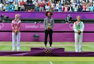 USA's Serena Williams (C), Russia's Maria Sharapova (L) and Belarus' Victoria Azarenka pose with their gold, silver and bronze medals respectively at the end of the women's singles tennis tournament of the London 2012 Olympic Games, at the All England Tennis Club in Wimbledon, southwest London, on August 4, 2012. AFP PHOTO / LUIS ACOSTA