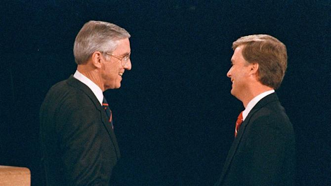 FILE - In this Oct. 5, 1988, file photo, Sen. Lloyd Bentsen, D-Texas, left, shakes hands with Sen. Dan Quayle, R-Ind., before the start of their vice presidential debate at the Omaha Civic Auditorium, Omaha, Neb. They spend hours mastering policy. Learning to lean on the podium just so. Perfecting the best way to label their opponents as liars without whining. But presidential candidates and their running mates often find that campaign debates turn on unplanned zingers, gaffes or gestures that speak volumes. Debate wins and losses often are scored based on the overall impressions that candidates leave with voters. In the history books, though, small debate moments often end up telling the broader story. (AP Photo/Ron Edmonds)