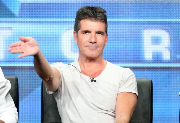 "Simon Cowell speaks onstage during the ""The X Factor"" panel discussion at the FOX portion of the 2013 Summer Television Critics Association tour - Day 9 at The Beverly Hilton Hotel on August 1, 2013 -- Getty Images"