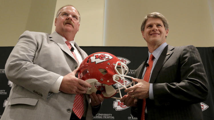 New Kansas City Chiefs NFL team head football coach Andy Reid, left, and owner Clark Hunt pose for photographers during a news conference at Arrowhead Stadium Monday, Jan. 7, 2013, in Kansas City, Mo. (AP Photo/Charlie Riedel)