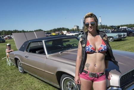 Nora Mattsson from Finland poses with her Thunderbird 1967 at the yearly Power Big Meet in Vasteras, Sweden