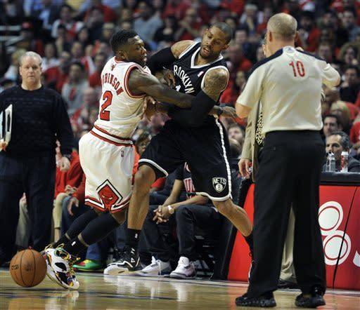 Robinson surge leads Bulls past Nets in triple OT
