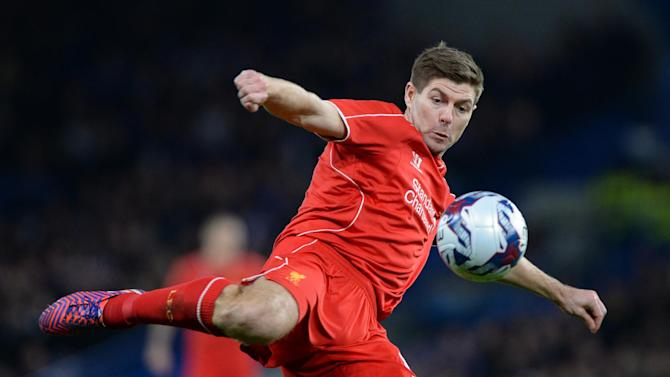 Liverpool's English midfielder Steven Gerrard volleys the ball during their English League Cup semi-final second leg football match against Chelsea at Stamford Bridge in London on January 27, 2015