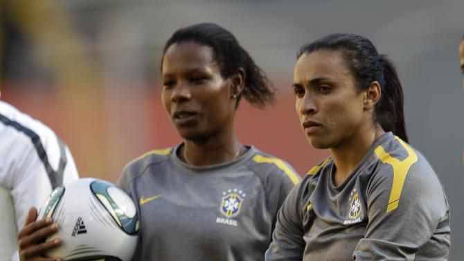 Brazil's Formiga, left, and Marta watch teammates practice penalty kicks during a training session in preparation for a quarterfinal match against the United States during the Women's Soccer World Cup in Dresden, Germany, Saturday, July 9, 2011. (AP Photo/Marcio Jose Sanchez)