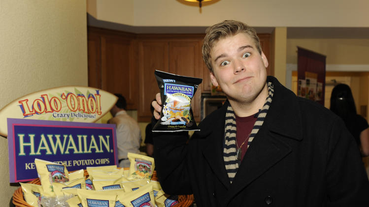 Actor Andrew Caldwell visits the Tim's Cascade Snacks Hawaiian Kettle Style Potato Chips booth at the Fender Music lodge during the Sundance Film Festival on Sunday, Jan. 20, 2013, in Park City, Utah. (Photo by Jack Dempsey/Invision for Fender/AP Images)
