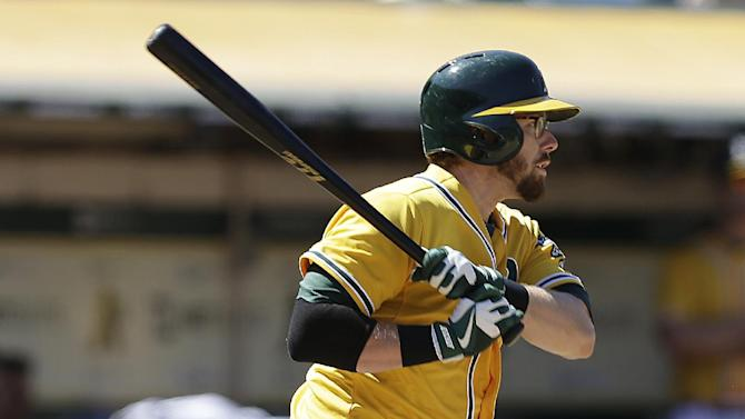 Cespedes helps A's rally to beat Angels 10-6