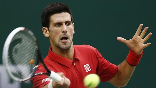 Novak Djokovic of Serbia hits a return to Marcel Granollers of Spain during their men's singles tennis match at the Shanghai Masters