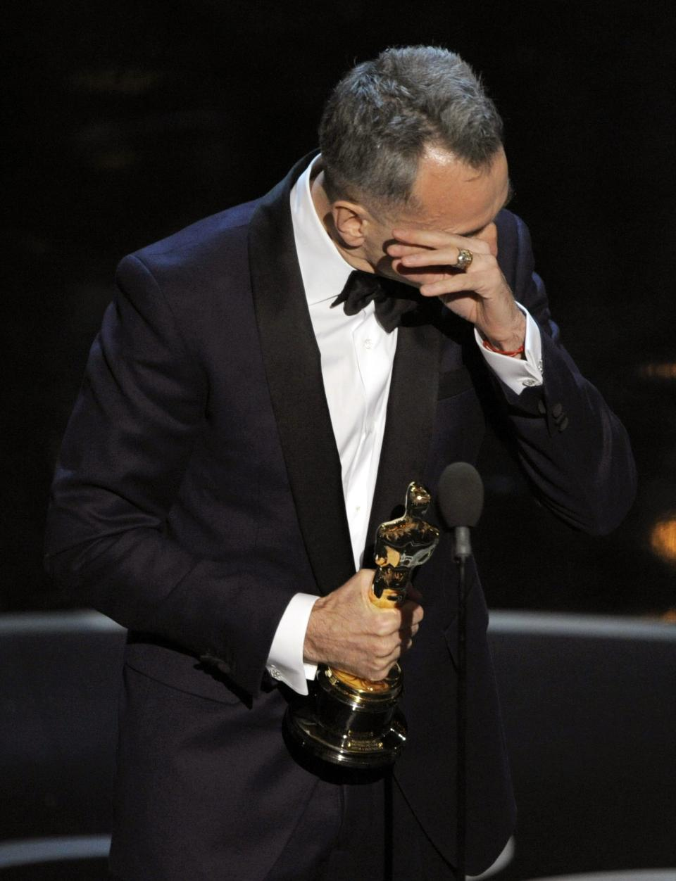 "Daniel Day-Lewis accepts the award for best actor in a leading role for ""Lincoln"" during the Oscars at the Dolby Theatre on Sunday Feb. 24, 2013, in Los Angeles.  (Photo by Chris Pizzello/Invision/AP)"