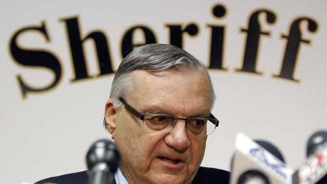 FILE - In this Jan. 10, 2012 photo, Maricopa County Sheriff Joe Arpaio conducts a news conference in Phoenix. Federal authorities on Wednesday, May 9, 2012 said that they plan to sue Arpaio and his office over allegations of civil rights violations, including the racial profiling of Latinos. (AP Photo/Matt York, File)