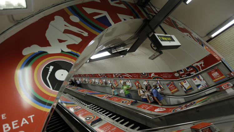 Olympic-themed decorations adorn the escalator leading down to the London underground in Hyde Park at the 2012 Summer Olympics, Tuesday, July 24, 2012, in London. (AP Photo/Marcio Jose Sanchez)