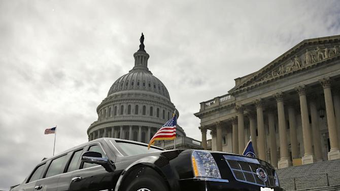 One of President Barack Obama's motorcade vehicles is seen parked in front of the US Capitol Building in Washington, Tuesday, March 12, 2013. Obama traveled to Capitol Hill to visit with Senate Democrats in the first of four meetings with lawmakers this week to discuss the budget. (AP Photo/Pablo Martinez Monsivais)