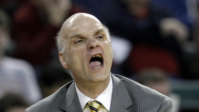 FILE - This March 9, 2012 file photo shows Saint Joseph's coach Phil Martelli shouting to his players during the second half of an NCAA college basketball game against St. Bonaventure in the quarterfinals at the Atlantic 10 men's tournament in Atlantic City, N.J. The NCAA is examining transfer rules after a spate of high-profile cases that has critics saying too much power is in the hands of athletic directors and coaches. The issue came to the forefront in men's basketball over the winter when 7-foot center Todd O'Brien went public with Martelli's decision to block his transfer to UAB. Neither Martelli nor school officials have said why. (AP Photo/Mel Evans, File)