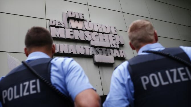 German police officers stand guard during trial of Kreshnik B. at Frankfurt courthouse