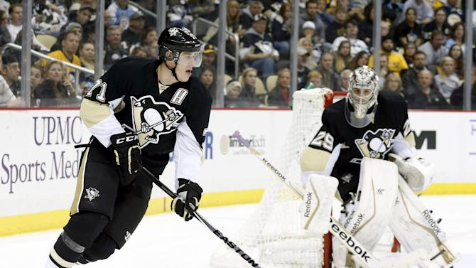 Evgeni Malkin and Justin Williams scrap, given roughing minors …