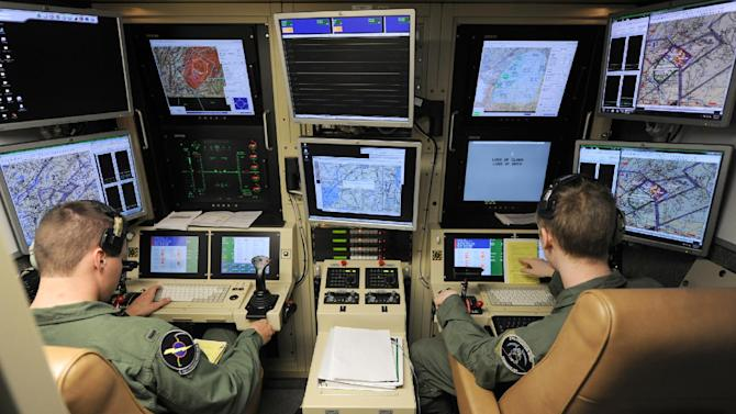 This photo taken June 6, 2012 and provided by the Defense Department shows a student pilot and sensor operator man the controls of a MQ-9 Reaper in a ground-based cockpit during a training mission flown from Hancock Field Air National Guard Base, Syracuse, New York. At the Air Force Academy in Colorado Springs, becoming a fighter pilot is still a hotly coveted goal. But slowly, a culture change is taking hold. Initially snubbed as second-class pilot-wannabes, the airmen that remotely control America's arsenal of lethal drones are gaining stature and securing a permanent place in the Air Force.  (AP Photo/TSgt Ricky Best, Defense Department)