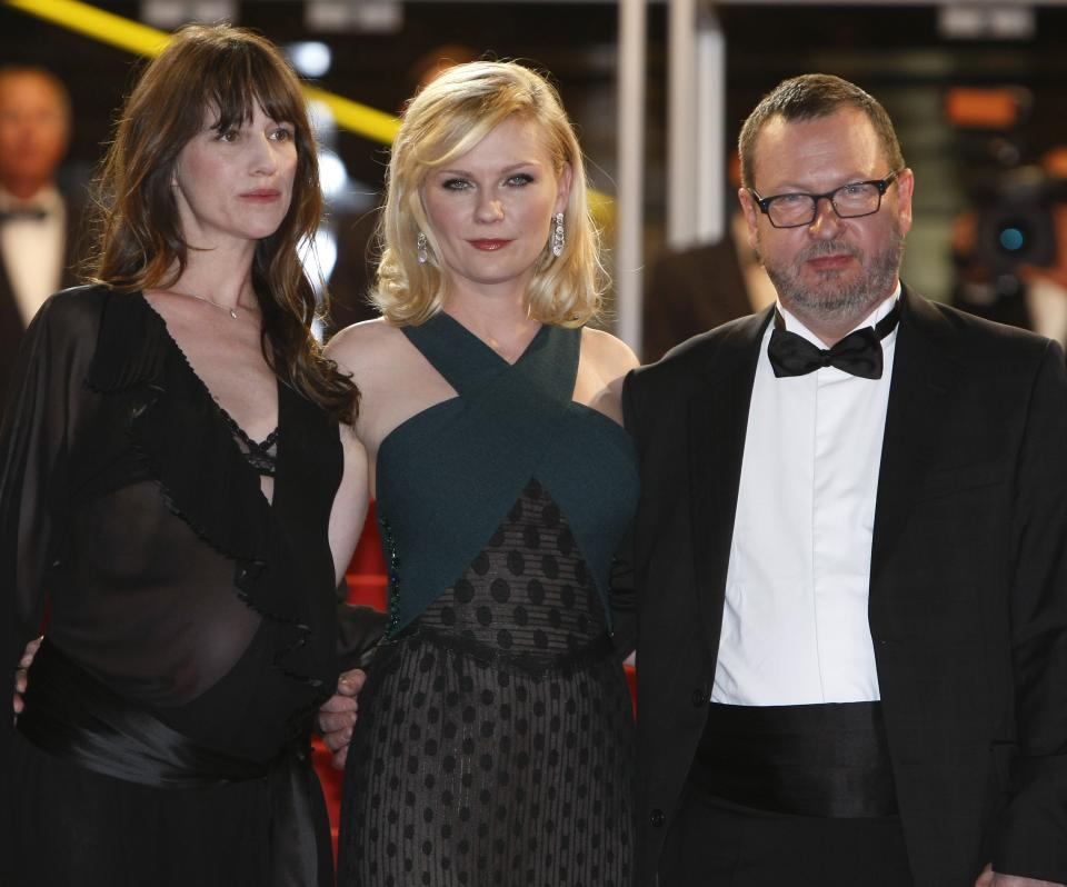 From left, actresses Charlotte Gainsbourg, Kirsten Dunst and director Lars Von Trier arrive for the screening of Melancholia at the 64th international film festival, in Cannes, southern France, Wednesday, May 18, 2011. (AP Photo/Francois Mori)