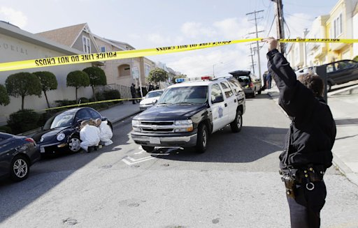 San Francisco Police officers inspect outside of a home on Howth Street in San Francisco, Friday, March 23, 2012. Five members of a family were found dead inside a home near San Francisco's City College in an apparent murder-suicide, police said Friday.