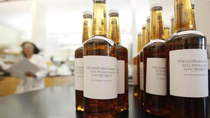 In this Thursday, April 19, 2012 photo, bottles of whiskey submitted for testing sit at a laboratory operated by the U.S. Department of Treasury's Alcohol and Tobacco Tax and Trade Bureau, in Beltsville, Md. The bureau, which collects taxes on booze and smokes and tells the companies that produce them how to do business, is one example of the specialized government offices threatened by Washington's current zeal for cost-cutting. (AP Photo/Charles Dharapak)