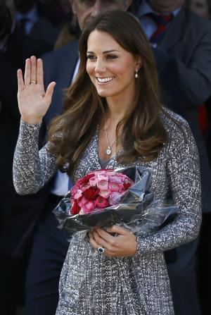 FILE - In this Tuesday, Feb. 19, 2013 file photo Britain's Kate, The Duchess of Cambridge waves as she leaves after a visit to Hope House, in London. It was announced on Monday, July 22, 2013, in London that Kate, Duchess of Cambridge and her husband Prince William, the Duke of Cambridge, gave birth to a boy weighting 8lbs 6 oz. (AP Photo/Kirsty Wigglesworth, File)