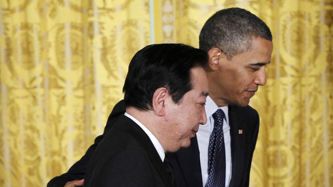 President Barack Obama and Japanese Prime Minister Yoshihiko Noda walk off stage after taking part in a joint news conference, Monday, April 30, 2012, in the East Room of the White House in Washington. (AP Photo/Pablo Martinez Monsivais)