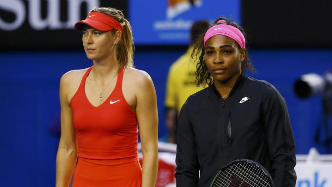 Williams of the U.S. and Sharapova of Russia pose for pictures before the start of their women's singles final match at the Australian Open 2015 tennis tournament in Melbourne